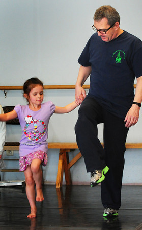 Salisbury: Caroline Lemos, 5, keeps her eye on Irish step dance instructor Thomas Bracken, whose studio is in Salisbury, as she learns some basic steps. She was one of a dozen children who were taking the lessons through the Newburyport Youth Services school vacation activities. Bryan Eaton/Staff Photo