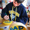 Newburyport: Kenny Hodge, 11, decorates a box and its top with homage to his mom and day on Tuesday afternoon. He was in arts and crafts at the Kelley School Teen Center. Bryan Eaton/Staff Photo