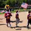 Newburyport: Lowell Spinners mascot Allie-Gator marches with the Pioneer League players for opening day on Saturday. Bryan Eaton/Staff Photo