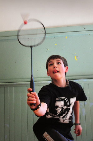 Newburyport: Kenny Hodge, 11, makes a hit in a badminton tournament Wednesday afternoon. He was at the Kelley School Teen Center in Newburyport. Bryan Eaton/Staff Photo