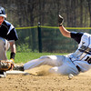 Byfield: A Hamilton-Wenham players slides to second on a steal as the ball bounced out of second baseman Bradley Whitman's glove. Bryan Eaton/Staff Photo
