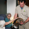 "Salisbury: Dean Kosch of Curious Creatures shows his tortoise  ""Gus"" at the Assisted Living Center in Salisbury on Tuesday afternoon. The presentation of different animals was part of thier Earth Week celebration. Bryan Eaton/Staff Photo"