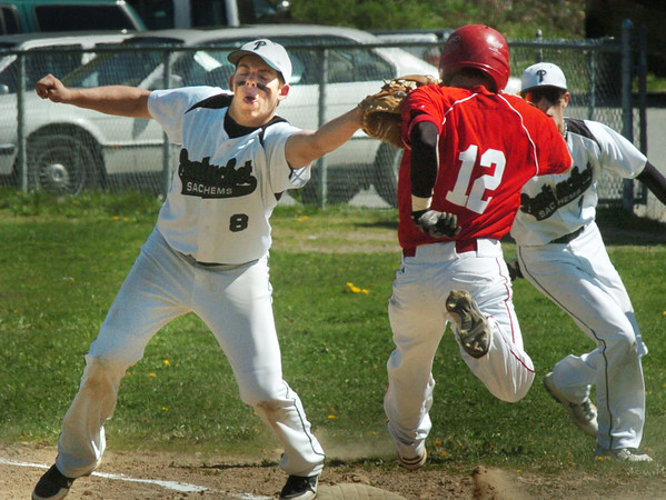 West Newbury: Pentucket first baseman Connor McGuirk slaps the tag on Masconomet's JR Sheehan. Bryan Eaton/Staff Photo