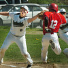 West Newbury: Pentucket first baseman Connor McGuirk slaps the tag on Masconomet's JR Sheehan. Bryan Eaton/Staff Photo