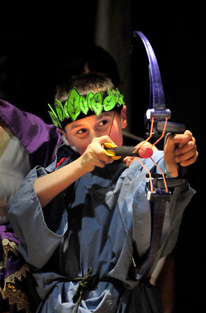 Amesbury: Max Doland, 12, takes aim as he competes in archery at the Olympic Games at Amesbury Middle School on Tuesday morning. The sixth-graders held their Greek Festival which caps a week of learning about the ancient culture. Bryan Eaton/Staff Photo