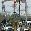 Salisbury: A work crew puts in a new utility pole on Route 110 in Salisbury at Crossroads Plaza yesterday afternoon. Bryan Eaton/Staff Photo