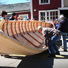 Amesbury: Volunteers help flip a 27' Pulling Boat under construction at Lowell's Boat Shop.  The boat is the largest known to have been built there and it necessitated being carried out to the street to be turned over for finishing.  The boat is destined for camp Wah Tut Ca in Northwood, N.H. to be used for Boy Scout training.  The shop plans on building an even larger boat next winter, a 28' whaleboat replica for the world's last remaining whaleship, the Charles W. Morgan at Mystic Seaport. Bryan Eaton/Staff Photo