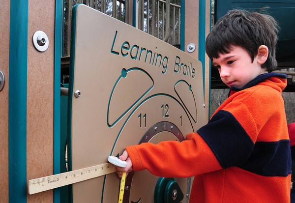 Amesbury: Dee Vachon's second grade class at the Cashman Elementary School in Amesbury were learning about different kinds of measurements. Yesterday they went outside to make measurements and Sean Celona, 8, added up some playground equipment.  Bryan Eaton/Staff Photo