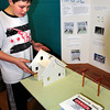 """Merrimac: Andrew Buzzell, 12, shows off models of a home connected by transmission lines to a power plant at the science fair at the Donaghue School in Merrimac. His project was """"What is the Power of Electricity."""" Bryan Eaton/Staff Photo"""