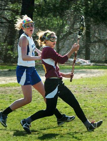 Georgetown: Newburyport's Kate McCauley moves towards the goal with Georgetown's Sara Gaeta in pursuit. Bryan Eaton/Staff Photo