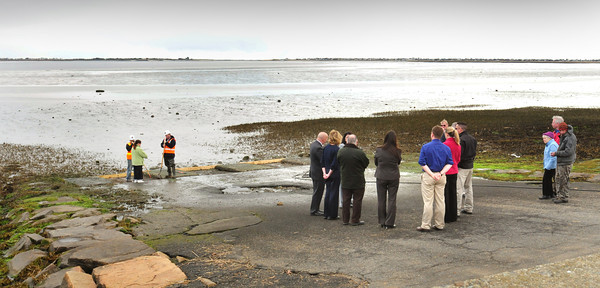 Newburyport: Local and state officials met yesterday at the boat slip next to Joppa Park on Water Street in Newburyport yesterday morning. The Massachusetts Fish and Game Department will be making repairs to the slip this morning and will later be refurbishing the whole area. Bryan Eaton/Staff Photo