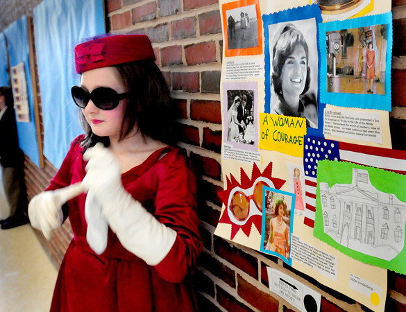 Amesbury: Sadie Vandenberg, 10, dresses the part of former First Lady Jacqueline Kennedy Onassis with white gloves and the sunglasses she wore later in life. She was part of the Wax Museum at Cashman School in Amesbury where children learn and present the lifes of people in history. Bryan Eaton/Staff Photo