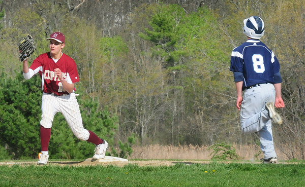 Byfield: Newburyport's Connor MacRae has the ball in hand forcing out Triton's Jedd Hutchins at first base. Bryan Eaton/Staff Photo