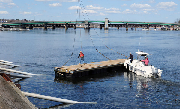 Newburyport: Newburyport Harbormaster crew moves the city's docks into place Friday as the boating season gets underway. Bryan Eaton/Staff Photo