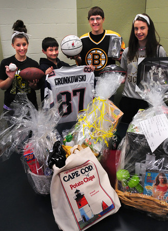 Salisbury: Many celebrity sports memorabilia will be on hand as well as much more will be up for auction at the Boys and Girls Club. Showing some off, are members, from left, Taylor Phillips, 15, Chris Gardella, 13, Dylan Tosi, 17, and Sarah Tobin, 15. Bryan Eaton/Staff Photo