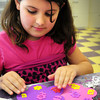 Salisbury: Cheyenne Nock, 8, works on a card for Mother's Day in the arts room at the Boys and Girls Club in Salisbury on Monday afternoon. She used sticky flower cutouts to adorn larger flower shapes she cut out. Bryan Eaton/Staff Photo