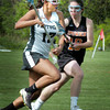 West Newbury: Pentucket's Sarah Higgins, left, trailed by an Ipswich player. Bryan Eaton/Staff Photo