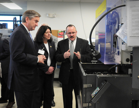 Newburyport: Congressman John Tierney visited Arwood Machine in Newburyport to talk about workforce development training and his new bill. Here, he and Newburyport Mayor Donna Holaday get a tour of the plant from David A. Munday, VP of Operations. Bryan Eaton/Staff Photo