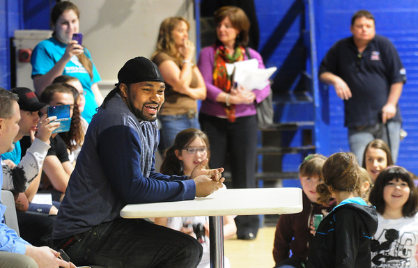 Salisbury: New England Patriot Jerrod Mayo speaks to children at the Boys and Girls Club on Tuesday. Questions posed to the inside linebacker ranged from how much money does he make to who's his favorite teammates. Bryan Eaton/Staff Photo