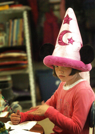 Amesbury: Elizabeth Cronin, 7, wears a wizard's hat in Billy McLane's class at Amesbury Elementary School on Monday. Children were writing essays about their school vacation and she wore the hat she got in Disney World last week. Bryan Eaton/Staff Photo