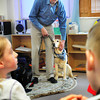 Newburyport: Randy Pierce talks to students about his relationship with his seeing eye dog, Quinn, at the Inn Street Montessori School in Newburyport. Pierce and his dog have made history as the first blind man and guide dog to summit all of New Hampshire's 4,000 foot mountains during a single winter. Bryan Eaton/Staff Photo