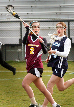 Newburyport: Newburyport's Kelsey Crowley looks for an open teammate with Triton's Kaitlyn Muldowney covering. Bryan Eaton/Staff Photo