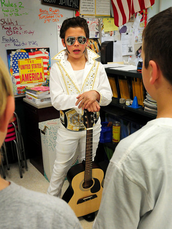Amesbury: Kaiden Henderson, 10, takes on the role of Elvis Presley presenting his life story to fellow students at the Cashman School in Amesbury on Thursday afternoon. They fourth-graders were putting on their Wax Museum where they researched a figure in history and presented them to classmates, and later to their parents. Bryan Eaton/Staff Photo