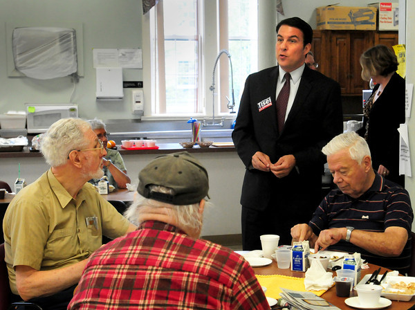 Amesbury: Republican challenger Richard Tisei to Congressman John Tierney meets people at the Amesbury Senior Center during lunch yesterday. Bryan Eaton/Staff Photo