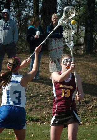 Newburyport: Newburyport's Lilly Donovan passes the ball as Georgetown's Morgan Gott tries to block. Bryan Eaton/Staff Photo