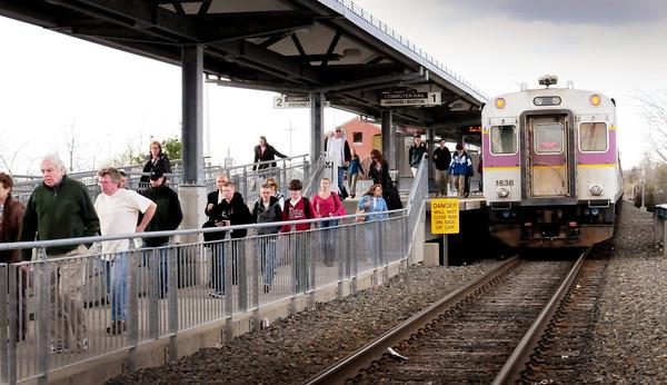 Newburyport: Riders get off the commuter rail in Newburyport yesterday afternoon. Bryan Eaton/Staff Photo