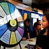 Byfield: Maiya Lawrence, 17, looks to see where the Reality Check wheel lands which will hit something good or bad monetarily reflecting the realities of life. She was one of scores of area high school students attending a Credit For Life Fair sponsored by the Institution for Savings at Triton Regional High School on Tuesday morning. Bryan Eaton/Staff Photo