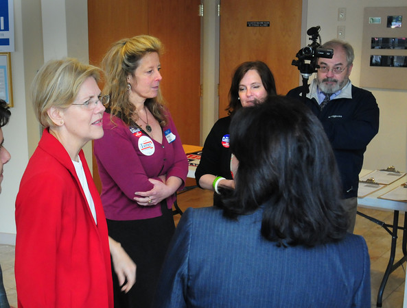 Newburyport: Candidate for senate Elizabeth Warren is greeted by Newburyport Mayor Donna Holaday, back to camera, as she enters the 7th Annual Democratic Three Town and Two Cities Breakfast. Bryan Eaton/Staff Photo