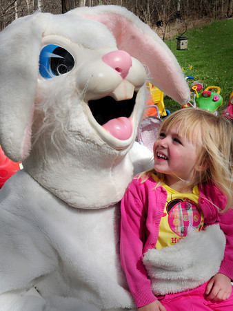 Salisbury: Sydney Champagne, 3, of Salisbury gets her picture taken with the Easter Bunny on Thursday afternoon. The special visitor came by after the children at Little Inspirations Daycare in Salisbury had an Easter Egg hunt. Bryan Eaton/Staff Photo