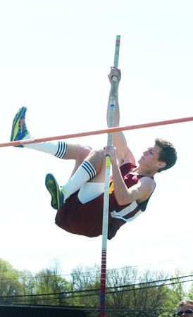 Newburport: Newburyport's John O'Neil cleared this bar in the pole vault in action with Triton yesterday. Bryan Eaton/Staff Photo