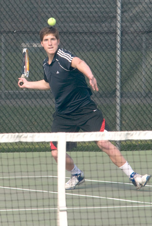 Byfield:  Amesbury's Grant Pelino keeps his eye on the ball against Triton's  Travis Mihalchik during his match with Friday at Triton. JIm Vaiknoras/staff photo