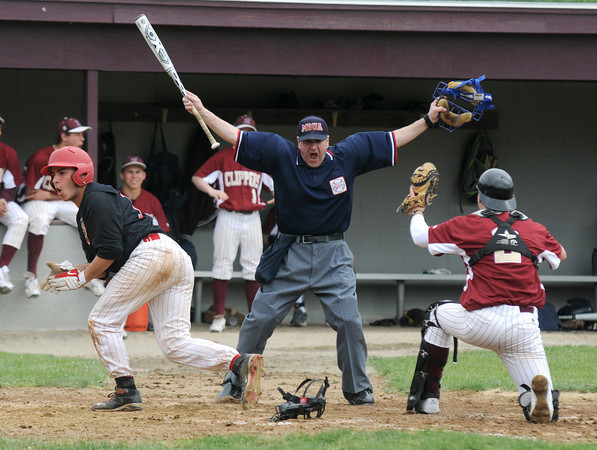 Newburyport: Newburyport's Jimmy Conway  holds up the ball in vain as  Umpire John Prisco of Wakefield calls Amesbury Noah Kligerman safe during the Clippers home game against Amesbury Saturday. Jim Vaiknoras/Staff photo