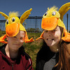 Newburyport: Melissa Bourne and Cameron Cyr model duck hats at the Newburyport Youth Services Duck Derby at the Mall in Newburyport Sunday. Jim Vaiknoras/staff photo