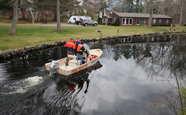 Amesbury: Emergancy personal search Lake Gardner for a missing tennn Sunday afternoon. Jim Vaiknoras/staff photo