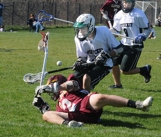 West Newbury: Pentucket's Quintin Bunnsy fouls Newburyport's Matt Kelleher during their game at Pipe Stave Hill Friday. Jim Vaiknoras/staff photo