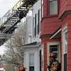 Newburyport: Firefighter respond to a fire on Prospect Street in Newburyport Sunday afternoon. Jim Vaiknoras/staff photo