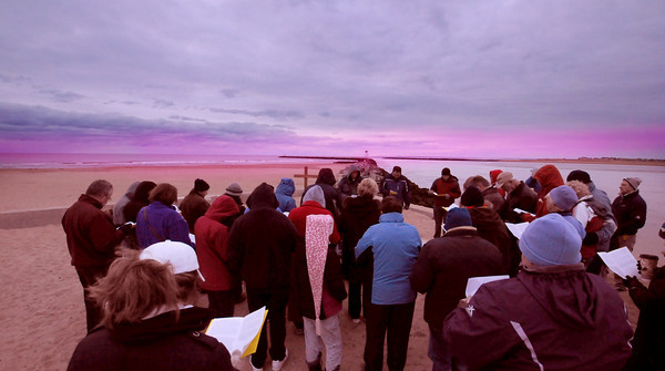 Salisbury: Parishioners from the Market Street Baptist Church in Amesbury celebrate Easter Services on Salisbury Beach at sunrise Sunday . Jim Vaiknoras/staff photo