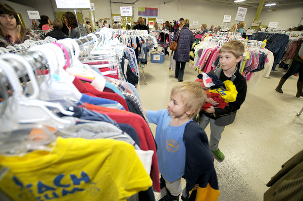 Newburyport:Alec McDougall , 9, and his brother Matthew, 5, of Newburyport pick out t-shirts at the Clothes for Hope clothing sale on Milikan Way in Newburyport Saturday. The event raised money for New Seed International and the children of teh Keta School District in Ghana. jim vaiknoras/staff photo