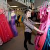 Newburyport: Amelia Laddyy a senior at Amesbury high looks over prom dresses at Pure Bliss in Newburyport Sunday. JIm Vaiknoras/staff photo