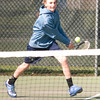 Byfield: Triton's first singles player Travis Mihalchik returns a serve during his match with Amesbury's Grant Pelino Friday at Triton. JIm Vaiknoras/staff photo