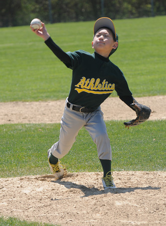 West Newbury: Brady Quin , 9, pitches for the Athletics against the Phillies on Opening day for the West Newbury Little League at Bachelor St. field Sunday. Jim Vaiknoras/staff photo