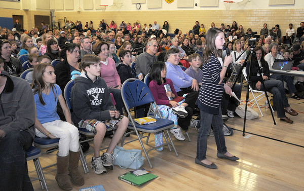 Newburyport: Julia Sullivan asks,  Jeff Kinney, author of Diary of a Whimp Kid, a question in a packed  gym an the Immaculate Conception School as part of the annual Newburyport Literary Festival. JIm Vaiknoras/staff photo