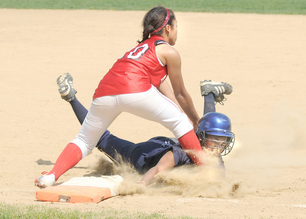Amesbury: Amesbury's Alexis Boswell tags out Andover's Domnique Cadet on a rtwo from the catcher during their game at Amesbury Friday. The Indian's won the game 6-3 in extra innings. JIm Vaiknoras/staff photo