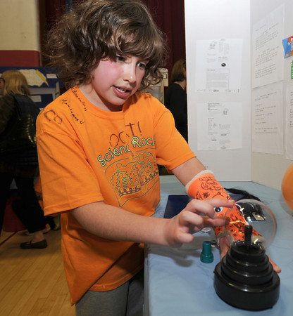 Newburyport: Third grader Emma Keith demostrates static electricity using a plasma lamp at the Besnahan Elementary Science Fair Thursday night. Jim Vaiknoras/staff photo