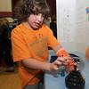 Newburyport: Third grader Emma Keith demostrates static electricity using a plasma lamp at the Besnahan Elementary Science Fair Thursday night. Jim Vaiknoras/staff photo