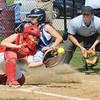 Amesbury:Triton'sKelsey Trudel slide safely home as  Amesbury's Cassandra Schultz waits for the throw during their game at Amesbury Middle School. Jim Vaiknoras/staff photo